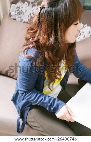 asia girl working on laptop - stock photo