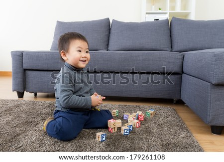 Asia little boy play toy block - stock photo