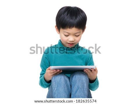 Asia little boy using tablet