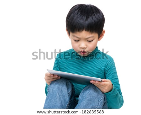 Asia little boy watching on tablet  - stock photo