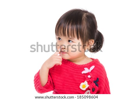 Asia little girl touch her nose - stock photo