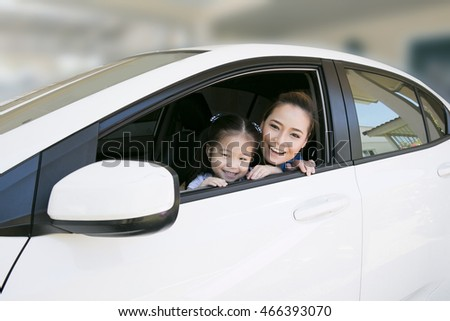 Asia mother and daughter in car, Asia Family