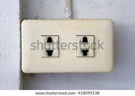 Asia plug socket. Plug socket on wall. Safe plug socket. Electric plug socket. Plug on wall. Electric plug cable. Unplug socket. Standard plug socket. Plug socket in room. Electric adapter. - stock photo