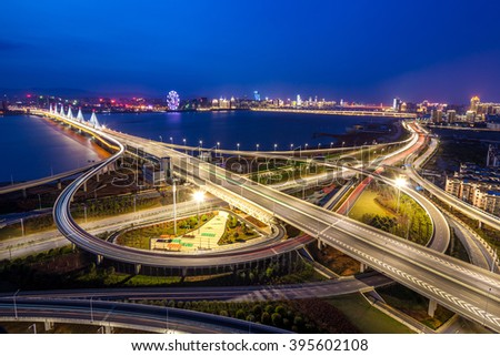 Asia's largest across the rivers in Shanghai landmarks a spiral bridge at night - stock photo