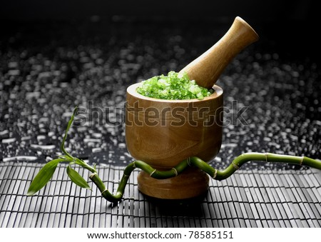 Asia still life wooden mortar and pestle with lucky bamboo on mat - stock photo