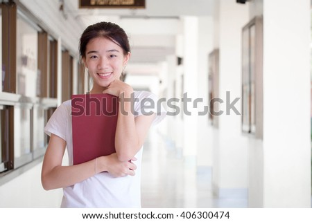 asia thai china student university beautiful girl read a book - stock photo