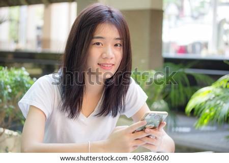 asia thai china student university beautiful girl using her smart phone. - stock photo
