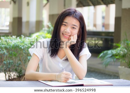 asia thai teenager Women White T-Shirt Writing - stock photo
