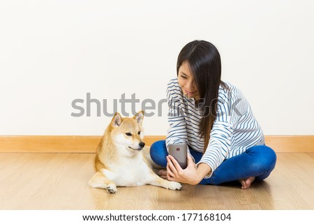 Asia woman and dog selfie - stock photo