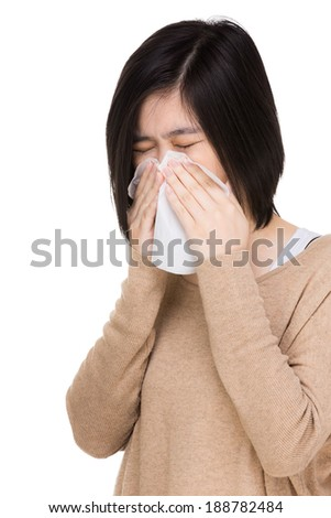 Asia woman blowing nose
