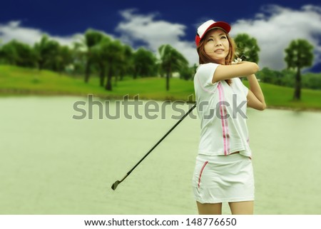 Asia woman golf player  - stock photo