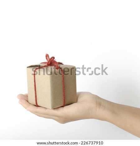 asia woman hand holding gift box on a white background - stock photo