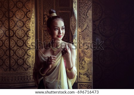 Asia woman in Traditional Thai dress.