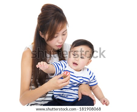 Asia woman play with her son - stock photo