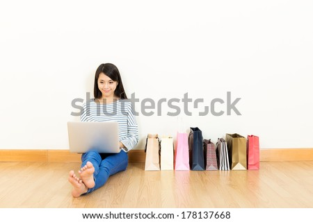 Asia woman shopping at home - stock photo