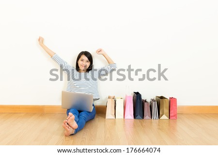 Asia woman shopping online at home - stock photo