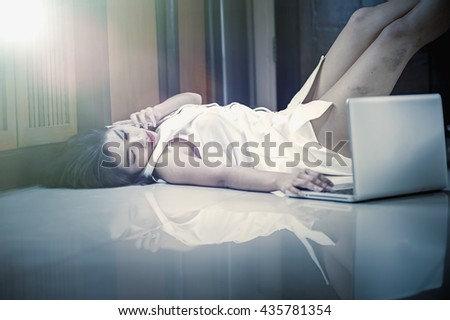 Asia woman using smart phone and laptop lying on the floor at home, add flare, vintage style