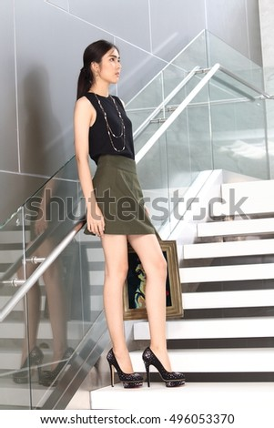 Asia Woman with Beautiful Leg and shoe with black open shoulder dress and green skirt