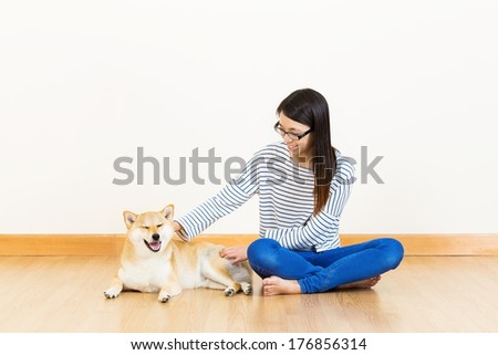 Asia woman with shiba at home - stock photo