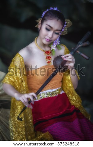 asia women in ancient Thai dress playing Pinpia or Thai music Instrument - stock photo