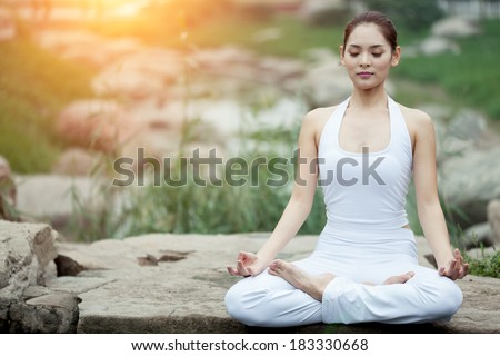 Asia Yoga instructor, in outdoor exercise - stock photo