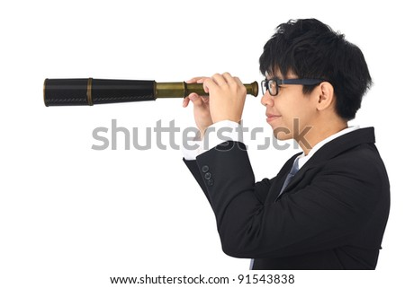 Asia young business man looks through a telescope - stock photo