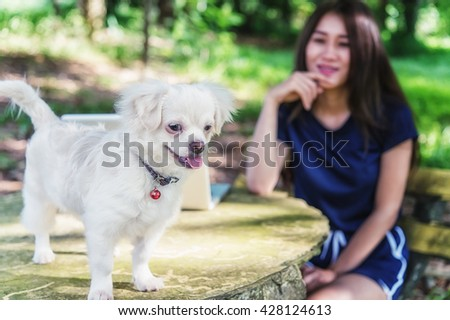 Asia Young happy woman with her dog and laptop