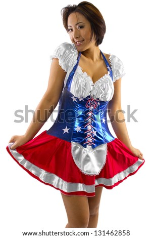 Asian American.  Young Asian female dressed in American flag costume and isolated on a white background - stock photo