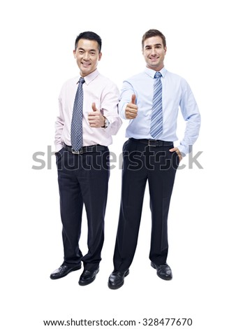 asian and caucasian business executives showing the thumb-up sign looking at camera smiling, isolated on white background. - stock photo