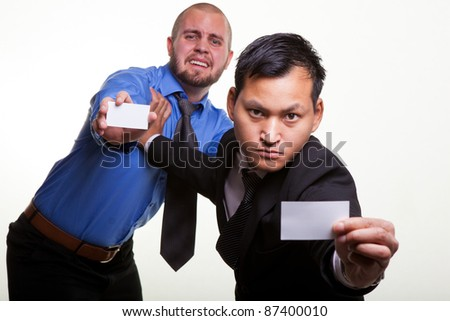 Asian and European  businessmen fighting to make business. - stock photo