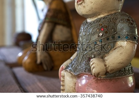 Asian antique doll