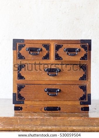 Asian antique wooden miniature drawer on the antique table