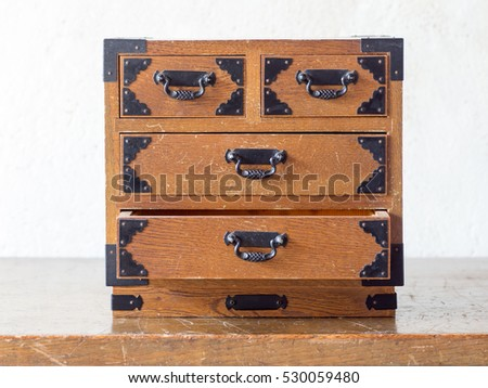 Asian antique wooden miniture drawer on the antique table