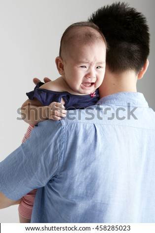 Asian Baby and father, Lying shoulder to cry on