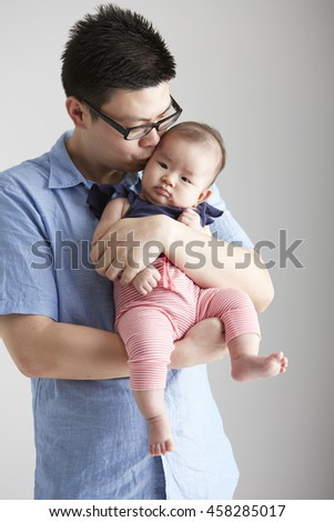 Asian Baby and father, parent child interaction