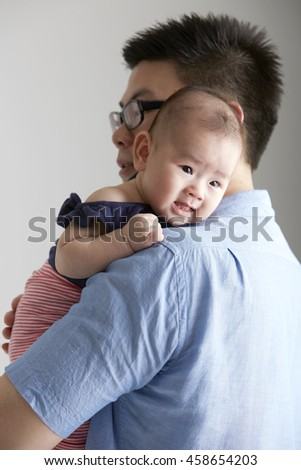 Asian baby and her father