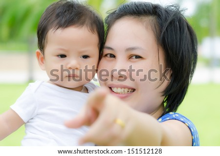 Asian Baby Boy and Mom in the Garden. - stock photo