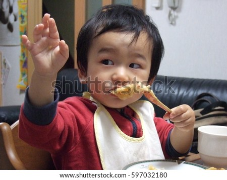 asian baby boy eats
