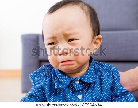 Asian baby boy feeling sad - stock photo