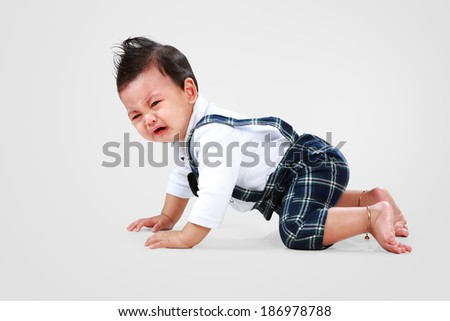 Asian baby boy lay down to crying - stock photo