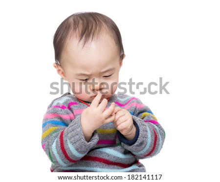 Asian baby boy looking at his finger