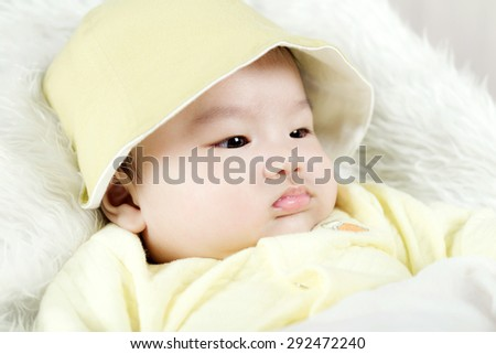 Asian baby boy lying on bed