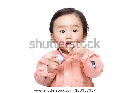 Asian baby boy play toy block isolated