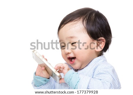 Asian baby boy play with mobile phone - stock photo