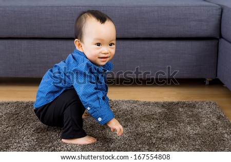 Asian baby boy playing at home - stock photo