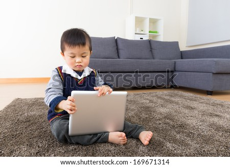 Asian baby boy using tablet - stock photo