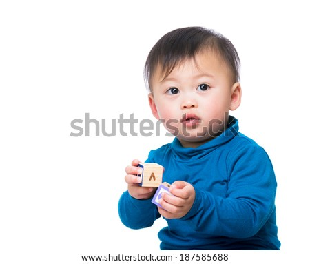 Asian baby boy with toy  - stock photo