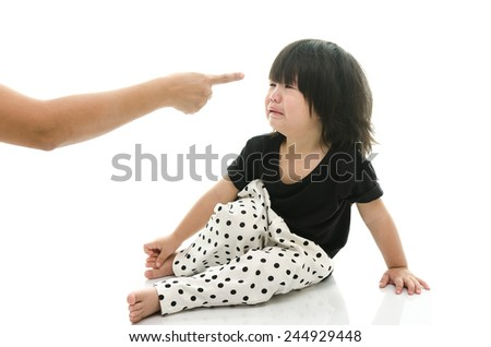 Asian baby crying while mother scolding on white background isolated - stock photo