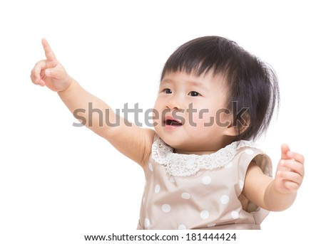 Asian baby girl finger pointing up