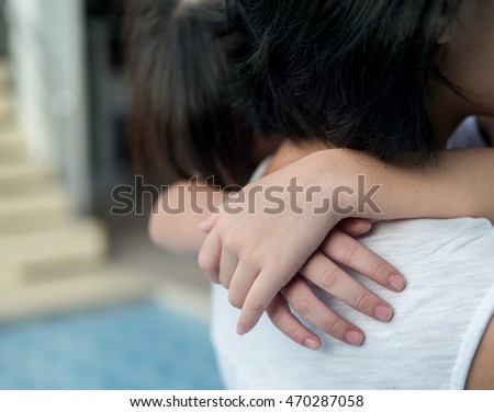 Asian baby girl hugging her mother , sleepy, selective focus at hands